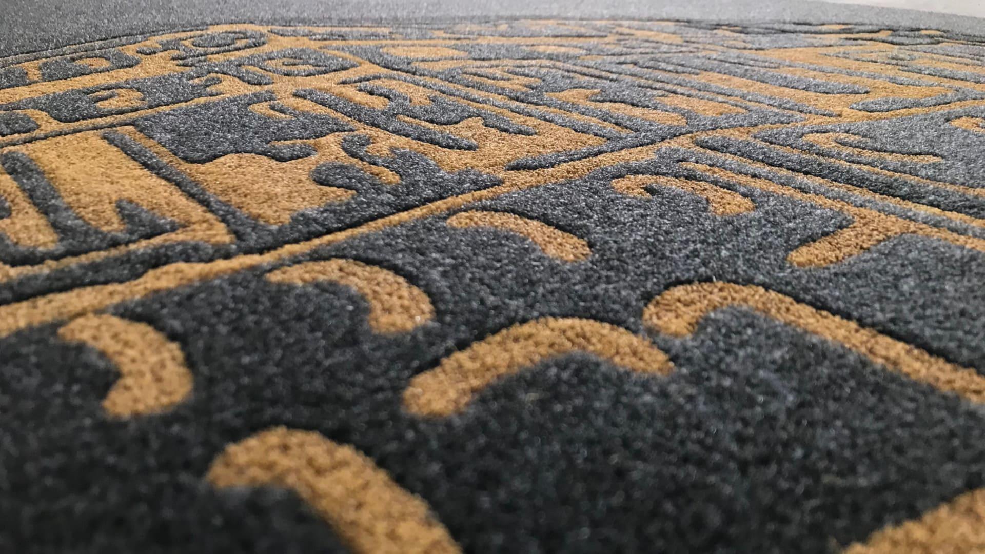 Dettaglio intarsio tappeti personalizzati MADO Group - Tappeti personalizzati con effetto rilievo